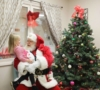 preschool_girl_and_santa_laughing_cadence_academy_preschool_greensboro_nc-502x450