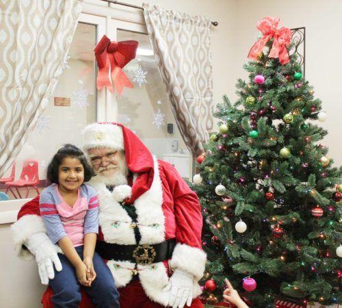 preschool_girl_and_santa_smiling_cadence_academy_preschool_greensboro_nc-500x450