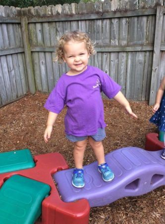 preschool_girl_balancing_on_bridge_cadence_academy_preschool_summerville_sc-333x450