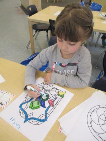 preschool_girl_coloring_flowers_adventures_in_learning_oswego_il-338x450