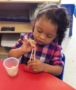 preschool_girl_doing_cheerio_activity_at_cadence_academy_preschool_northeast_columbia_sc-382x450