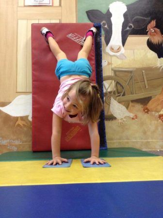 preschool_girl_doing_handstand_off_the_wall_at_cadence_academy_collegeville_pa-336x450
