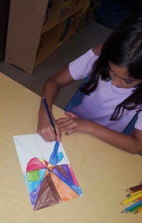 preschool_girl_drawing_geometric_shapes_winwood_childrens_center_brambleton_ii_va-287x450
