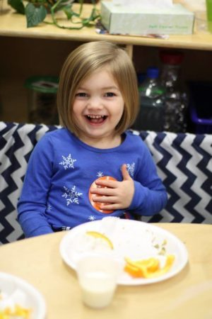 preschool_girl_eating_lunch_cadence_academy_preschool_steele_creek_charlotte_nc-300x450