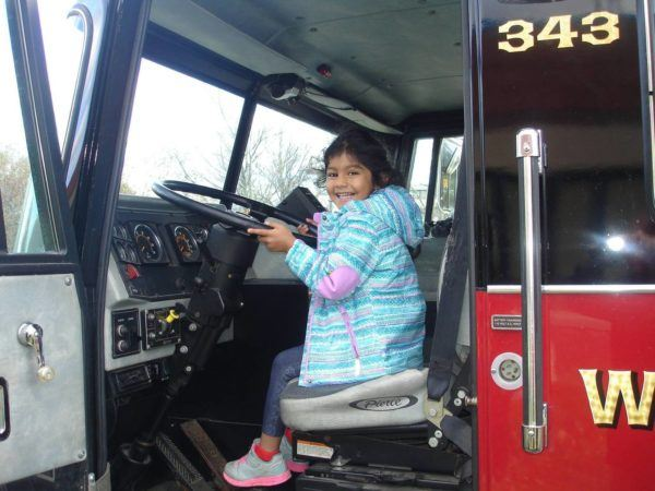 preschool_girl_enjoying_being_in_fire_truck_at_next_generation_childrens_centers_westborough_ma-600x450