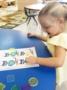 preschool_girl_enjoying_button_cat_activity_cadence_academy_preschool_myrtle_beach_sc-333x450