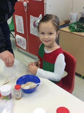 preschool_girl_enjoying_cooking_activity_growing_kids_academy_fredericksburg_va-333x450