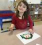 preschool_girl_enjoying_finger_painting_activity_cadence_academy_preschool_westerly_ri-427x450
