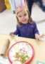 preschool_girl_enjoying_thanksgiving_dinner_at_cadence_academy_preschool_i_street_sacramento_ca-321x450