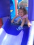 preschool_girl_going_down_slide_at_next_generation_childrens_centers_hopkinton_ma-336x450