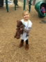 preschool_girl_holding_teddy_bear_on_playground_at_the_peanut_gallery_temple_tx-333x450