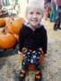 preschool_girl_in_pumpkin_patch_cadence_academy_preschool_wilmington_nc-338x450