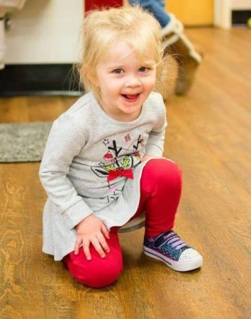 preschool_girl_in_red_leggings_cadence_academy_preschool_wilmington_nc-354x450