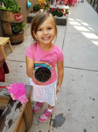 preschool_girl_in_the_school_garden_phoenix_childrens_academy_private_preschool_chandler_heights-336x450