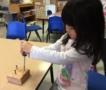 preschool_girl_learning_how_to_drive_screw_cadence_academy_preschool_urbandale_ia-532x450