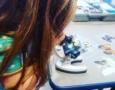 preschool_girl_looking_through_microscope_winwood_childrens_center_lansdowne_va-574x450