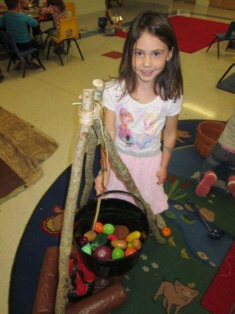 preschool_girl_making_stone_soup_cadence_academy_ballantyne_charlotte_nc-338x450
