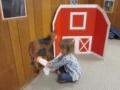 preschool_girl_milking_cow_cadence_academy_preschool_urbandale_ia-600x450