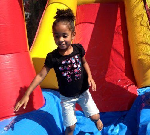 preschool_girl_on_inflatable_slide_cadence_academy_preschool_northeast_columbia_sc-502x450