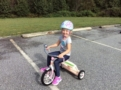 preschool_girl_on_tricycle_cadence_academy_preschool_greensboro_nc-605x450