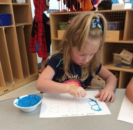 preschool_girl_painting_letter_b_winwood_childrens_center_gainesville_ii_va-463x450