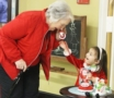 preschool_girl_playing_phone_with_grandmother_at_cadence_academy_preschool_lexington_sc-518x450