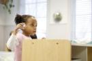 preschool_girl_playing_with_airplane_toy_winwood_childrens_center_leesburg_va-675x450