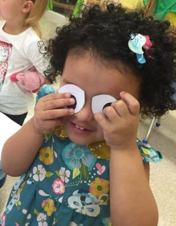 preschool_girl_playing_with_googly_eyes_prime_time_early_learning_centers_east_rutherford_nj-351x450