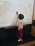 preschool_girl_playing_with_smart_board_winwood_childrens_center_fairfax_va-338x450