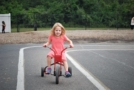 preschool_girl_riding_tricycle_at_next_generation_childrens_centers_franklin_ma-672x450
