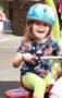 preschool_girl_riding_tricycle_with_helmet_carolina_kids_child_development_center_fort_mill_sc-287x450