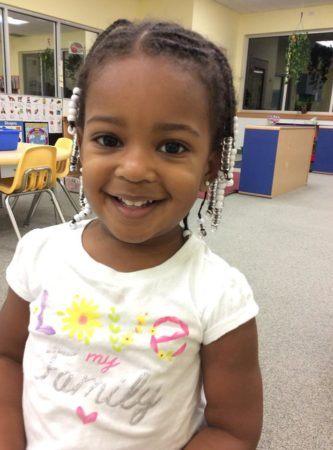 preschool_girl_smiling_in_classroom_at_cadence_academy_preschool_cypress_houston_tx-333x450