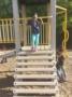preschool_girl_smiling_on_playground_equipment_sunbrook_academy_at_chapel_hill_douglasville_ga-335x450