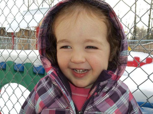 preschool_girl_smiling_on_playground_winwood_childrens_center_fairfax_va-600x450