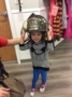 preschool_girl_trying_on_firefighter_helmet_cadence_academy_preschool_main_street_normal_il-336x450