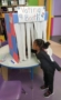 preschool_girl_voting_at_the_voting_booth_prime_time_early_learning_centers_middletown_ny-273x450