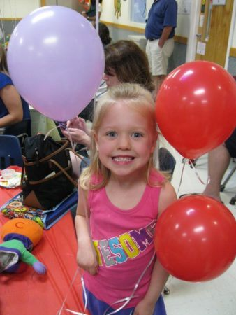 preschool_girl_with_balloons_at_next_generation_childrens_centers_marlborough_ma-338x450