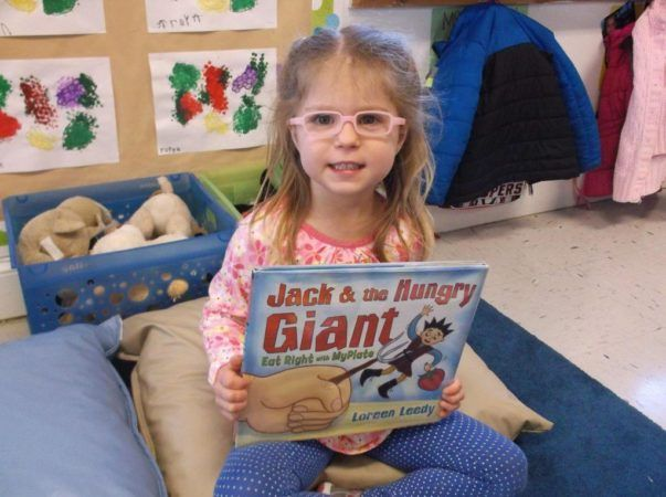 preschool_girl_with_book_at_cadence_academy_ballantyne_charlotte_nc-1024x764-603x450