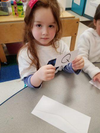 preschool_girl_with_letter_q_card_winwood_childrens_center_gainesville_ii_va-338x450
