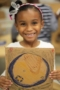 preschool_girl_with_map_of_the_world_cadence_academy_preschool_steele_creek_charlotte_nc-300x450