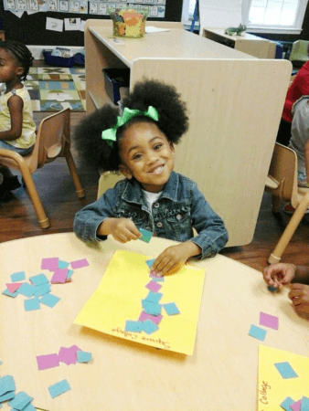 preschool_girl_with_small_square_art_project_sunbrook_academy_at_chapel_hill_douglasville_ga-338x450