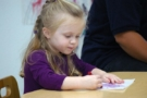 preschool_girl_writing_cadence_academy_preschool_fayetteville_ar