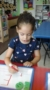 preschool_girl_writing_the_letter_e_prime_time_early_learning_centers_edgewater_nj-248x450