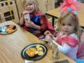 preschool_girls_eating_lunch_in_costumes_canterbury_academy_at_prairie_ridge_olathe_ks-600x450