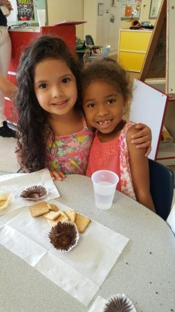 preschool_girls_enjoying_snack_at_cadence_academy_preschool_rosemeade_carrollton_tx-253x450