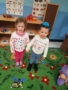 preschool_girls_holding_hands_during_dominican_republic_celebration_prime_time_early_learning_centers_farmingdale_ny-338x450