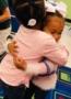 preschool_girls_hugging_at_cadence_academy_preschool_summerville_sc-324x450