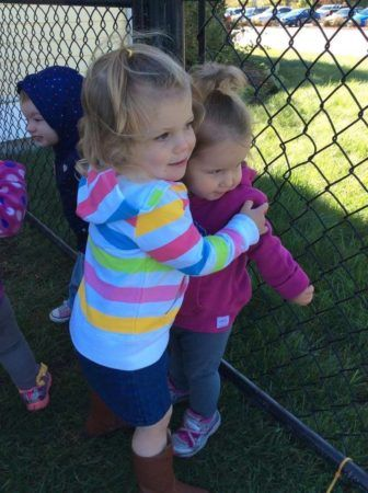 preschool_girls_hugging_at_next_generation_childrens_centers_franklin_ma-336x450