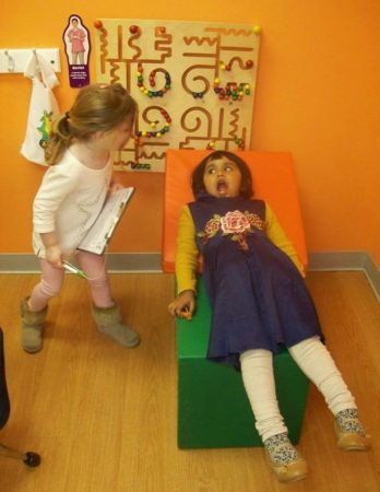 preschool_girls_playing_doctor_at_next_generation_childrens_centers_marlborough_ma-348x450