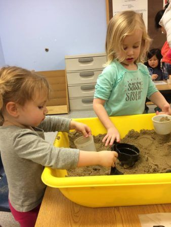 preschool_girls_playing_with_sand_at_next_generation_childrens_centers_marlborough_ma-338x450